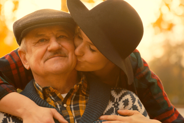 Happy portrait of young woman and her senior father
