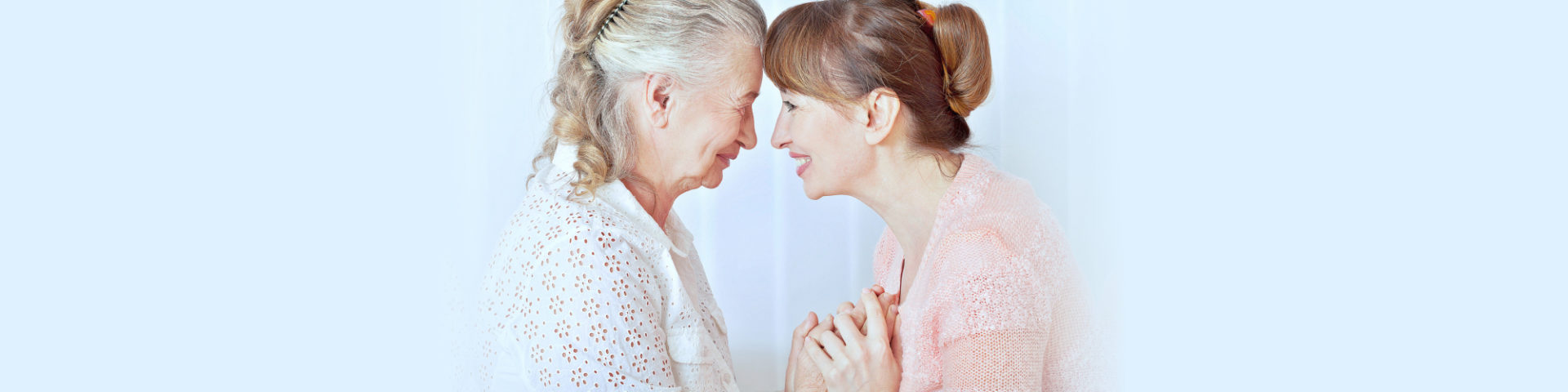 Seniors women with her caregiver at home